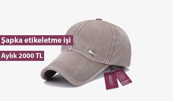 Evde şapka etiketleme işi